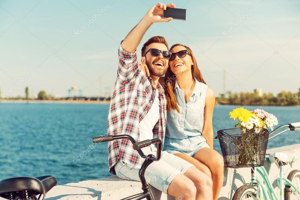 couple making selfie near bicycles