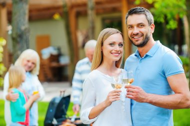 young couple holding wine glasses
