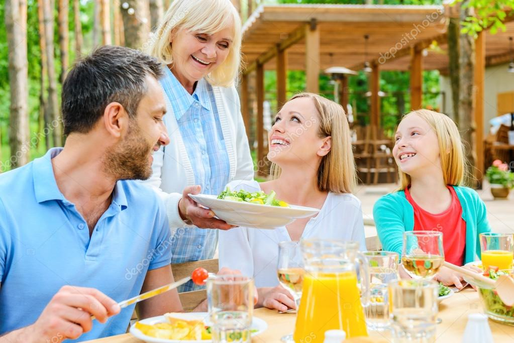 Family enjoying meal outdoors stock photo gstockstudio for Meal outdoors