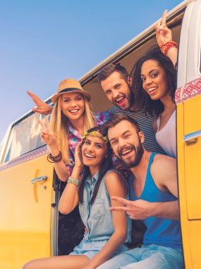 people sitting inside of retro mini van