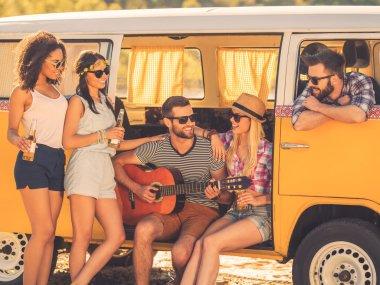 people enjoying time near retro minivan