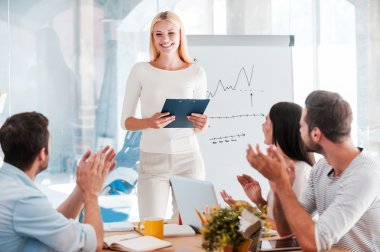 woman standing near whiteboard and smiling