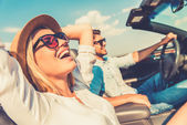 Fotografie woman and her boyfriend in convertible