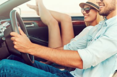 woman with her boyfriend sitting in convertible