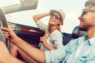 woman with her boyfriend driving convertible