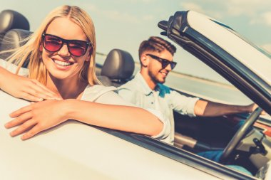 Woman and her boyfriend in convertible