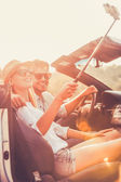 couple making selfie inside of convertible
