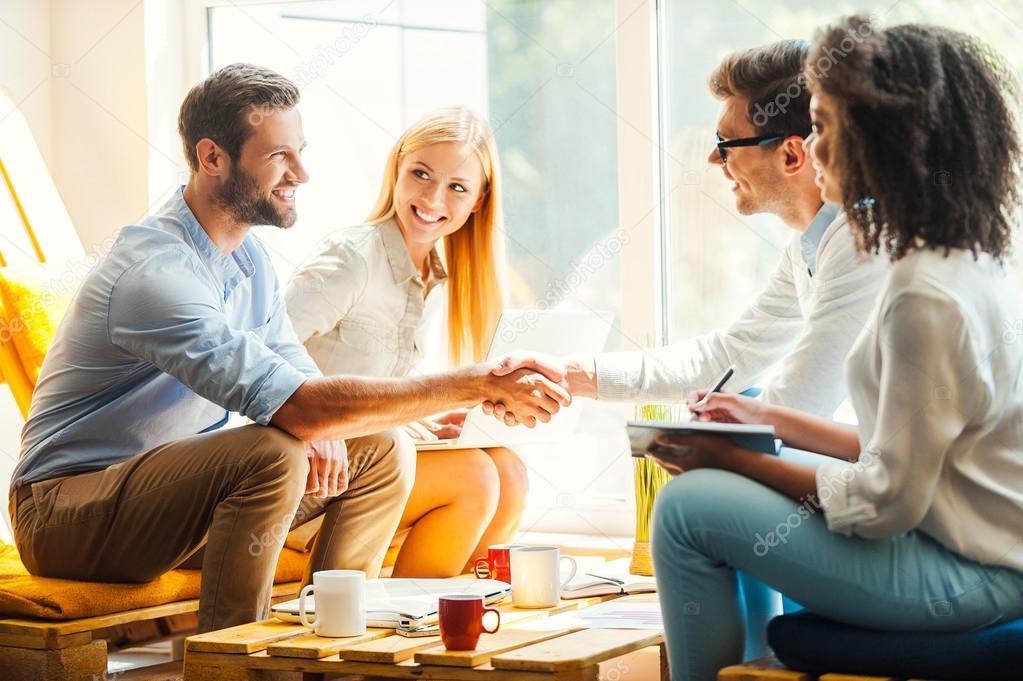 women working and men shaking hands