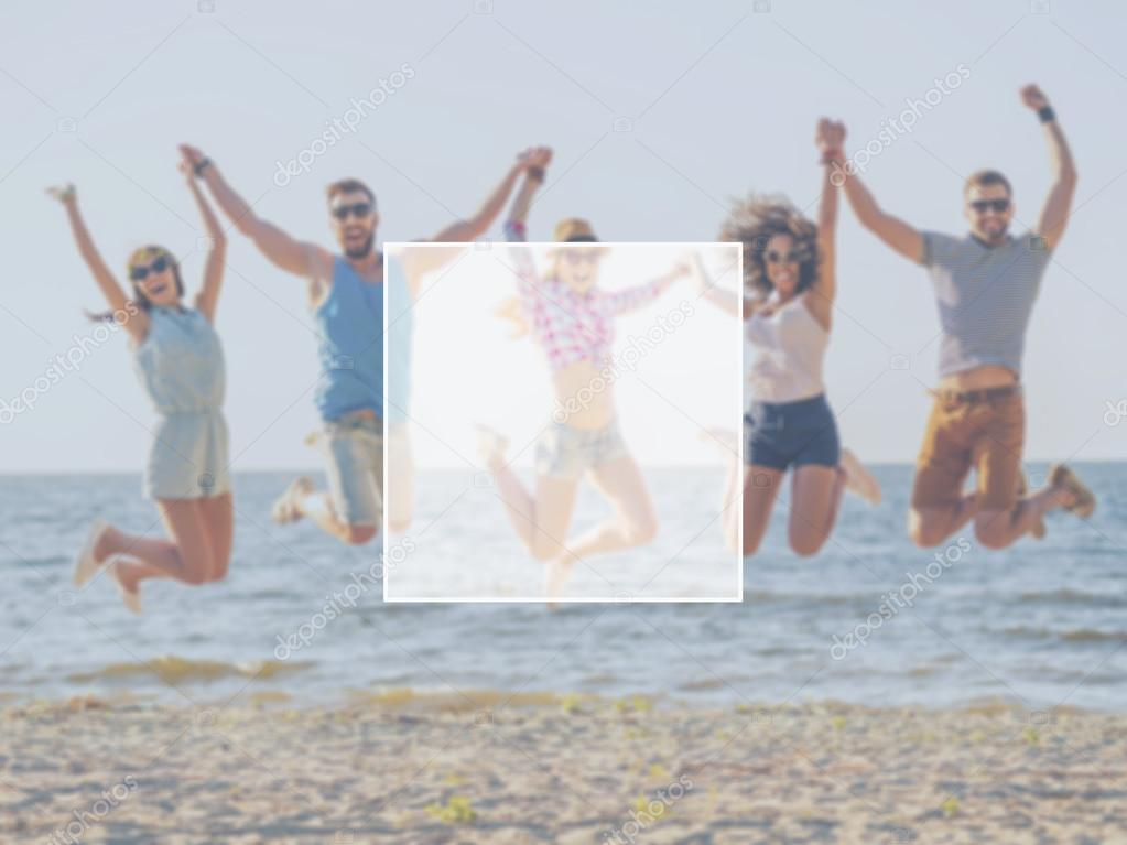happy people jumping over sea