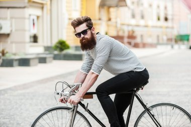 handsome bearded man with bicycle