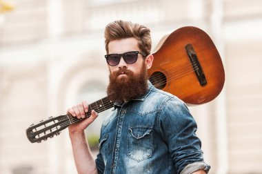 Handsome  musician with guitar