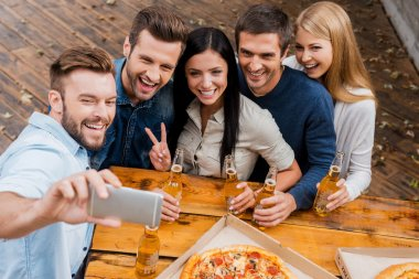 people holding beer and making selfie