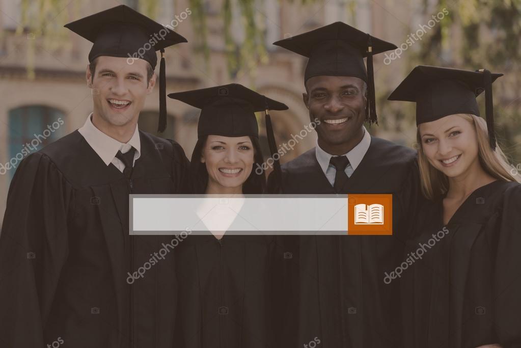 college graduates in graduation gowns — Stock Photo © gstockstudio ...