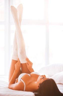 woman in lingerie adjusting her white socks