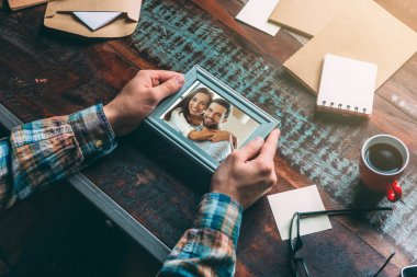 Man holding picture frame