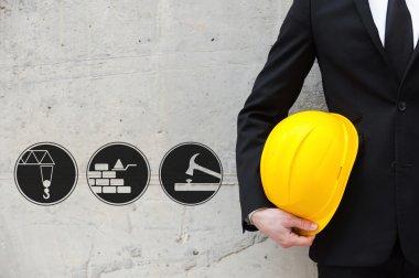 white collar worker holding hardhat