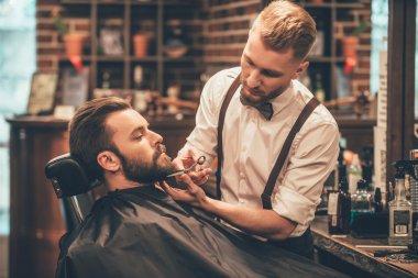 Young handsome man in barbershop