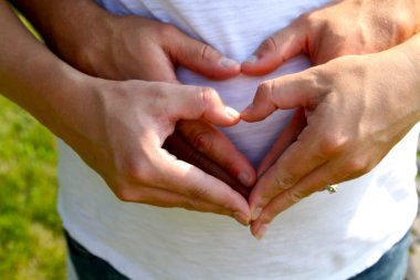 Hand Hearts on Pregnant Belly