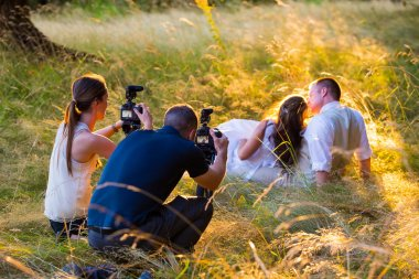 Videographers Filming Bride and Groom at Wedding