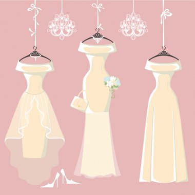 Bridal dresses hang on ribbons