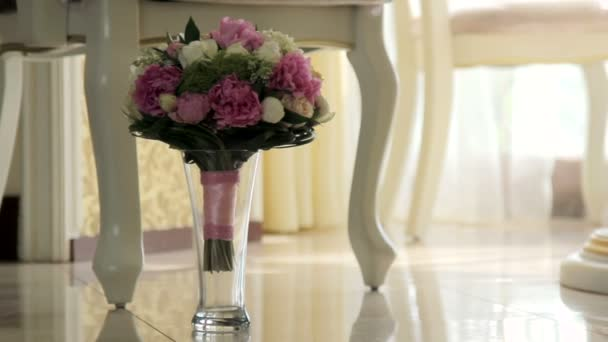 Bridal bouquet in an interior room.Wedding bouquet in a vase on the floor.Wedding interior.