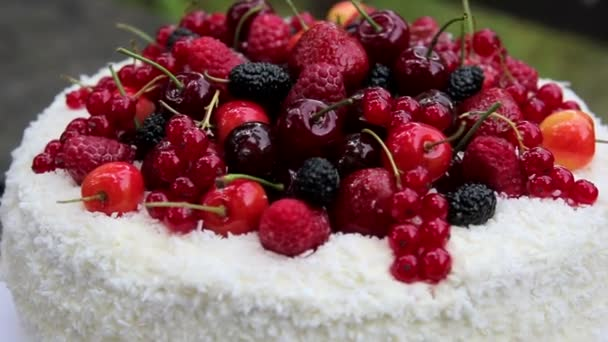 Fruit cake with coconut flakes with jelly berries.Fruit jelly cake.Berry, birthday cake.Culinary masterpieces.Summer holiday dessert.
