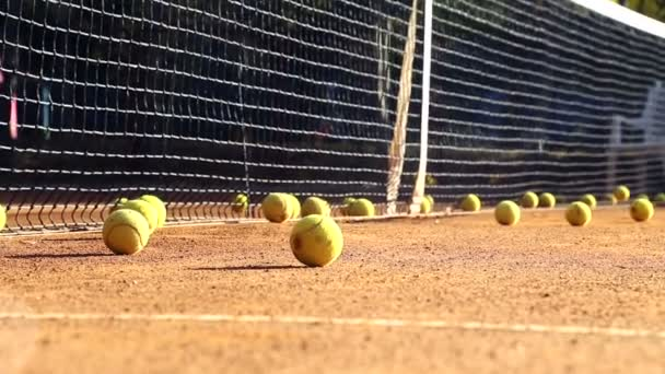 Tennis court before the game.Balls on the tennis court.Balls roll down to cover a tennis court.