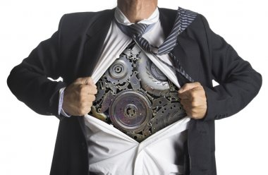 Businessman showing a superhero suit underneath machinery metal gears idea concept