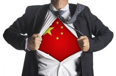 China flag with businessman showing a superhero suit