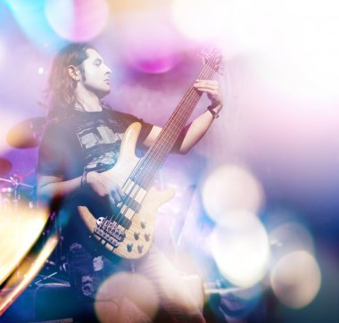 Man playing bass guitar in live concert sequence. Live music background