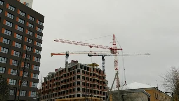 High-rise construction with large cranes in the city