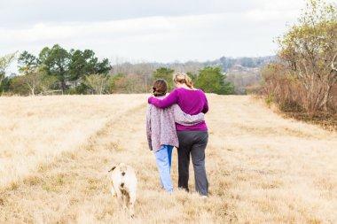 Mother Daughter Walking Hugging Outdoors