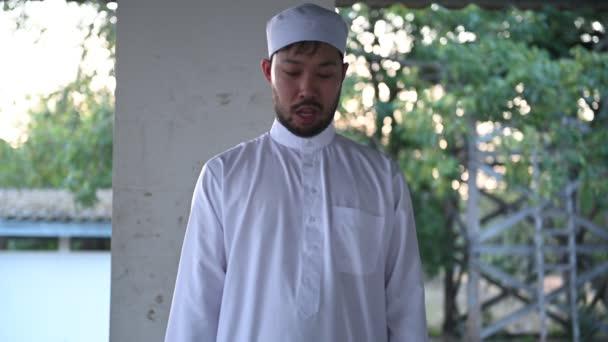 Young asian muslim man praying at daytime, Ramadan festival concept