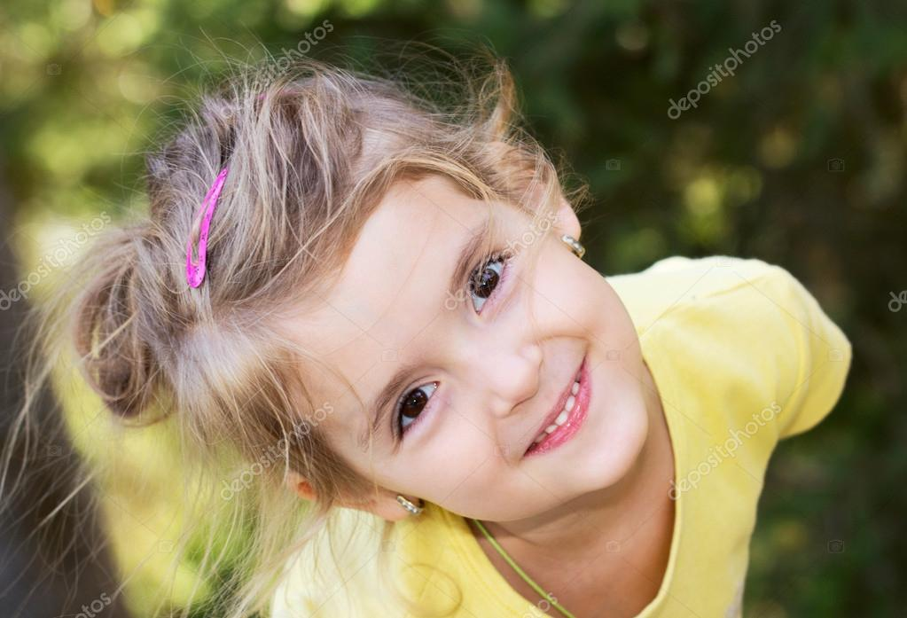 Happy little girl.Child outdoor closeup smiling face ...