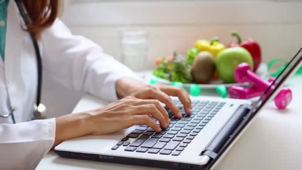 Nutritionist giving working on laptop and consultation to patient with healthy fruit and vegetable, Right nutrition and diet concept