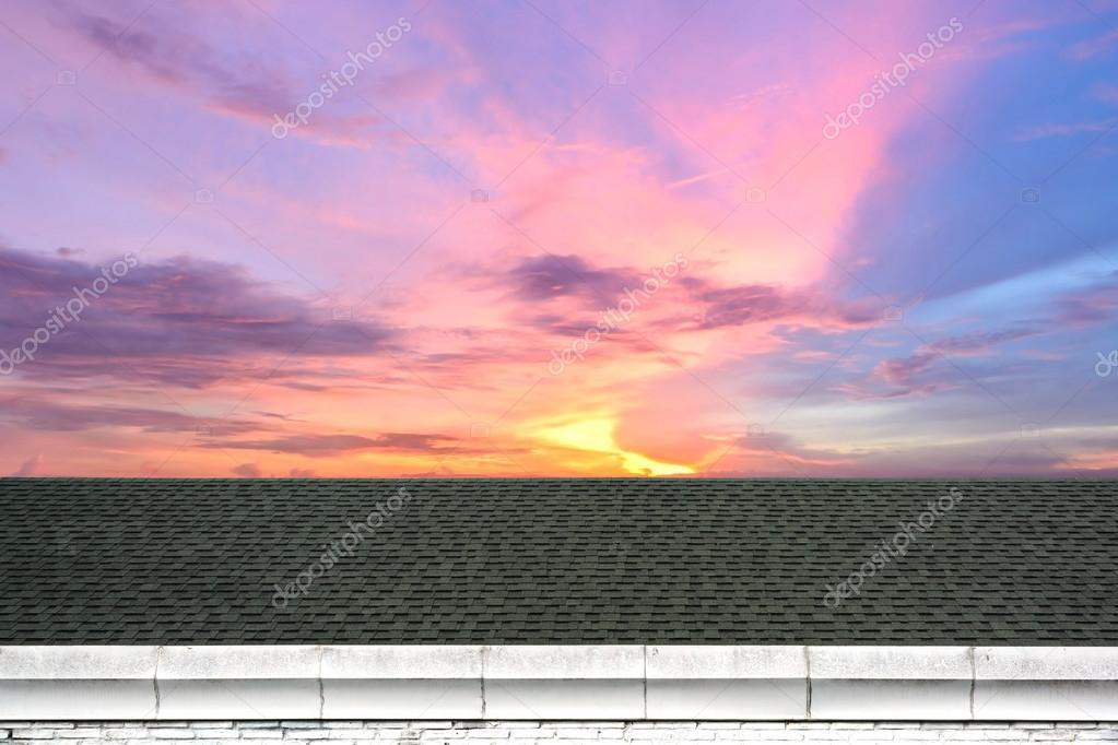 a beautiful sky at sunset with Roof