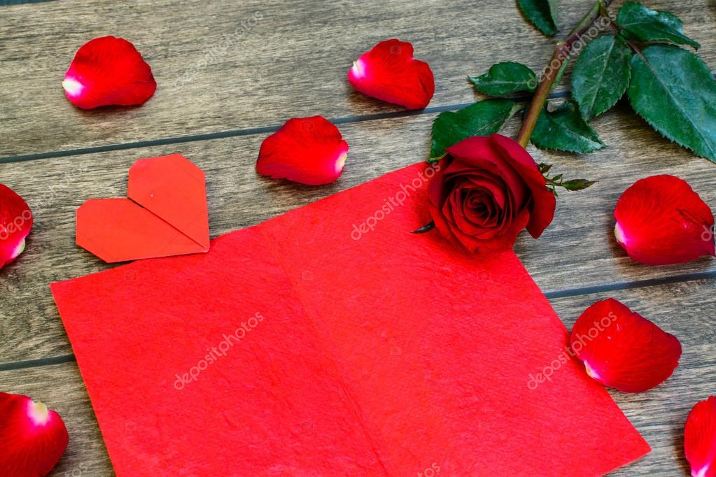 Red rose with heart shape