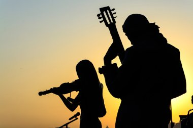 Silhouette of band playing the music
