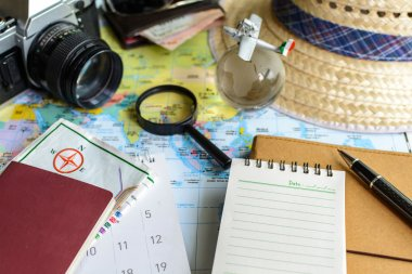 diary and calendar with passport and map