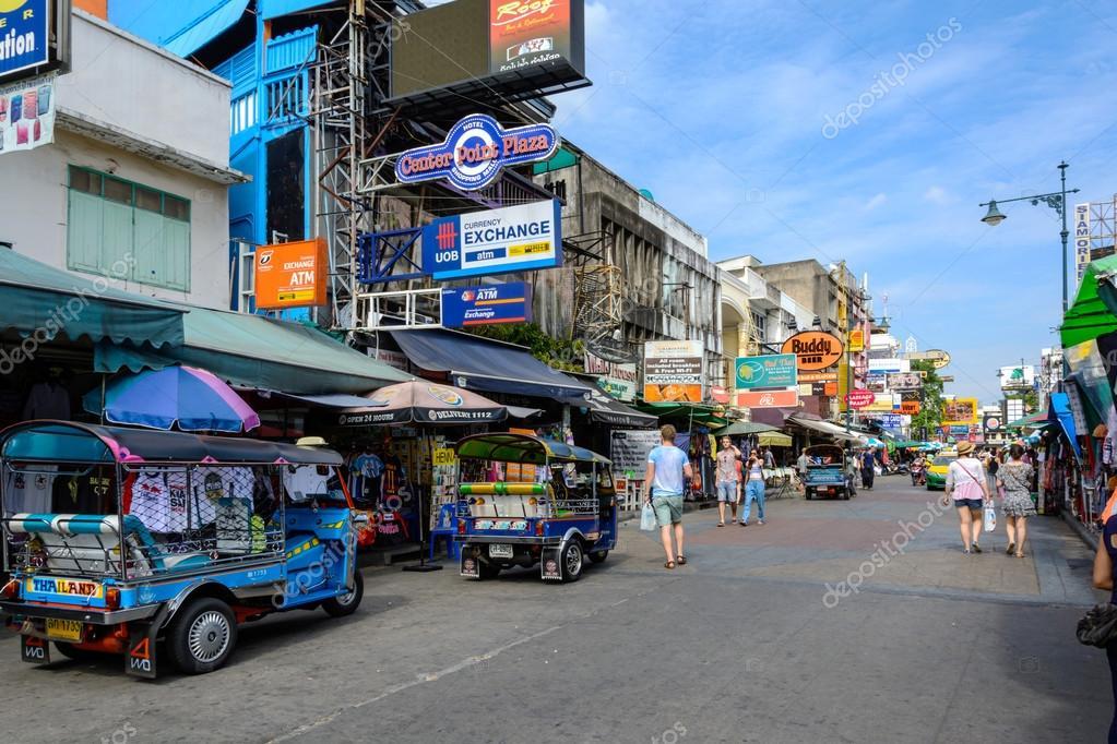 tourists walk along backpacker haven Khao San Road