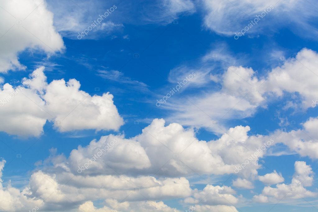 white fluffy clouds with the beautiful blue sky background