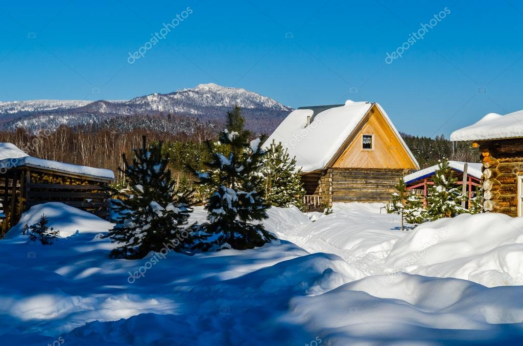 Winter village in the mountains of the Urals. Russia