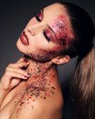 Fotografie schönes Mädchen mit fantastischen Make up für Halloween