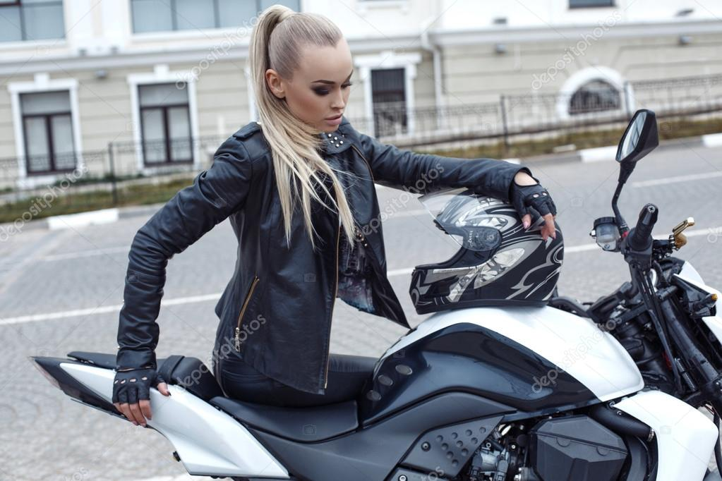 e9ecbb834 sexy girl with long blond hair in leather jacket