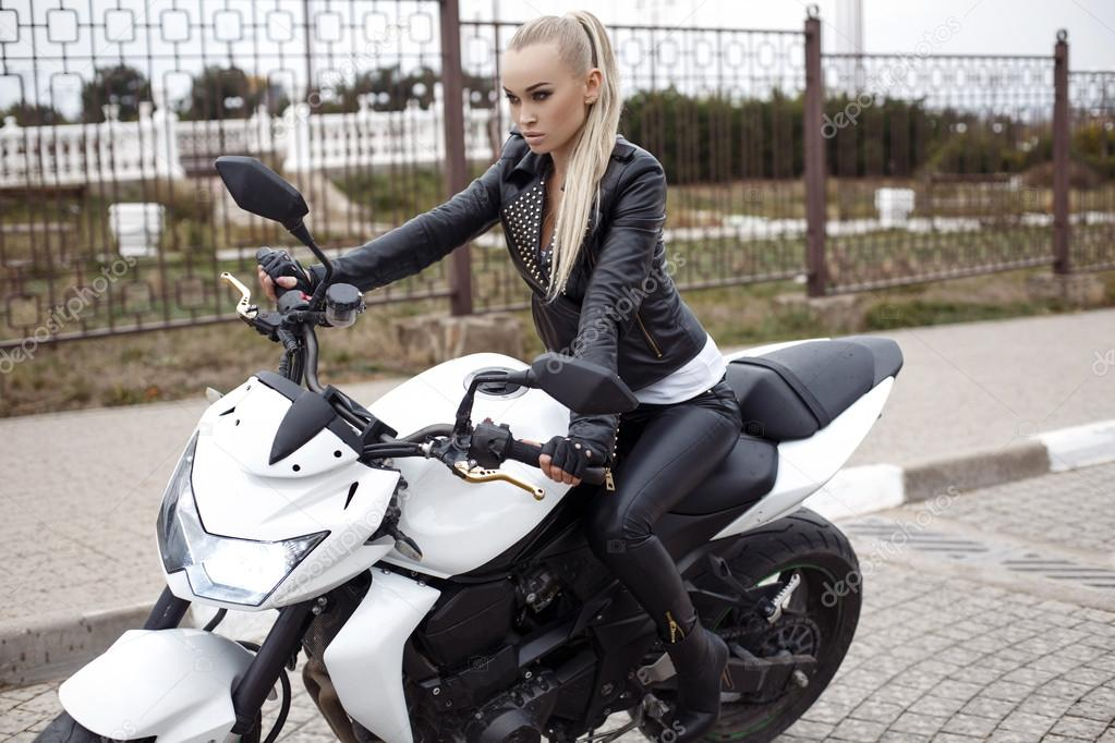Y With Long Blond Hair In Leather Jacket Posing On Motorbike Stock Photo