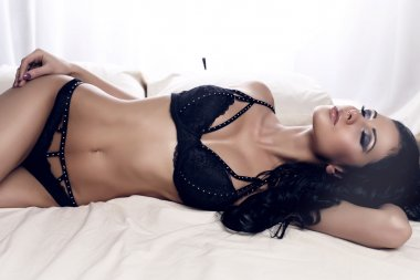 sexy beautiful woman with dark hair wearing elegant black lingerie