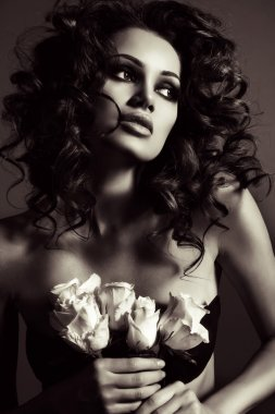 Fashion portrait of beautiful sexy woman with luxurious curly hair
