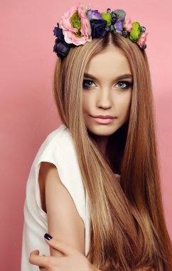 beautiful young girl with long straight hair with bright  flower's headband
