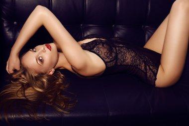 beautiful sensual girl with long dark hair wearing luxurious lace lingerie,