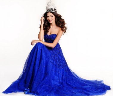 gorgeous winner of beauty contest wearing luxurious sequin dress and precious crown
